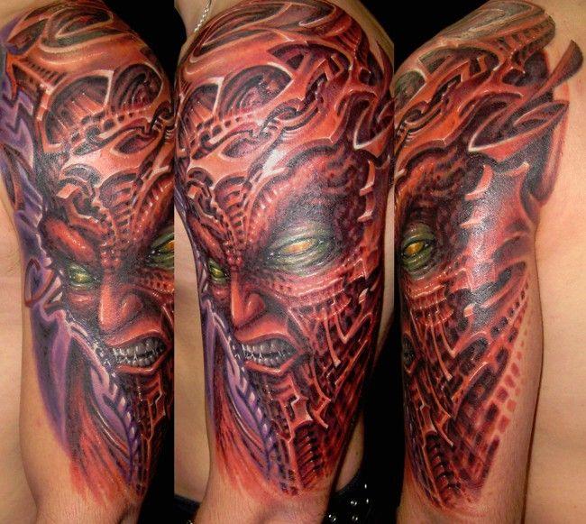 Resultados de la Búsqueda de imágenes de Google de http://poundedink.com/top-tattoo-artists/wp-content/uploads/2012/09/Dan-Hazelton-Color-Biomech-Face-Tattoo-Pannel.jpg