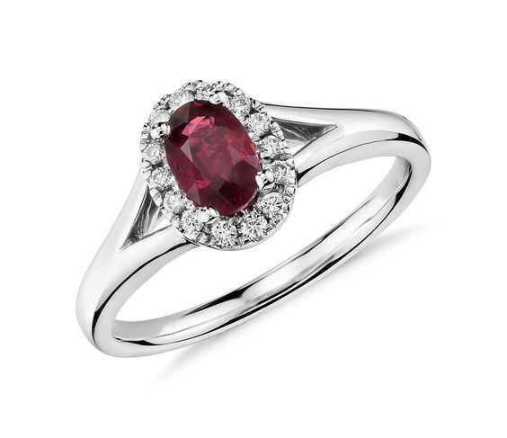 Oval Ruby And Diamond Halo Ring In 18k White Gold Jewellery