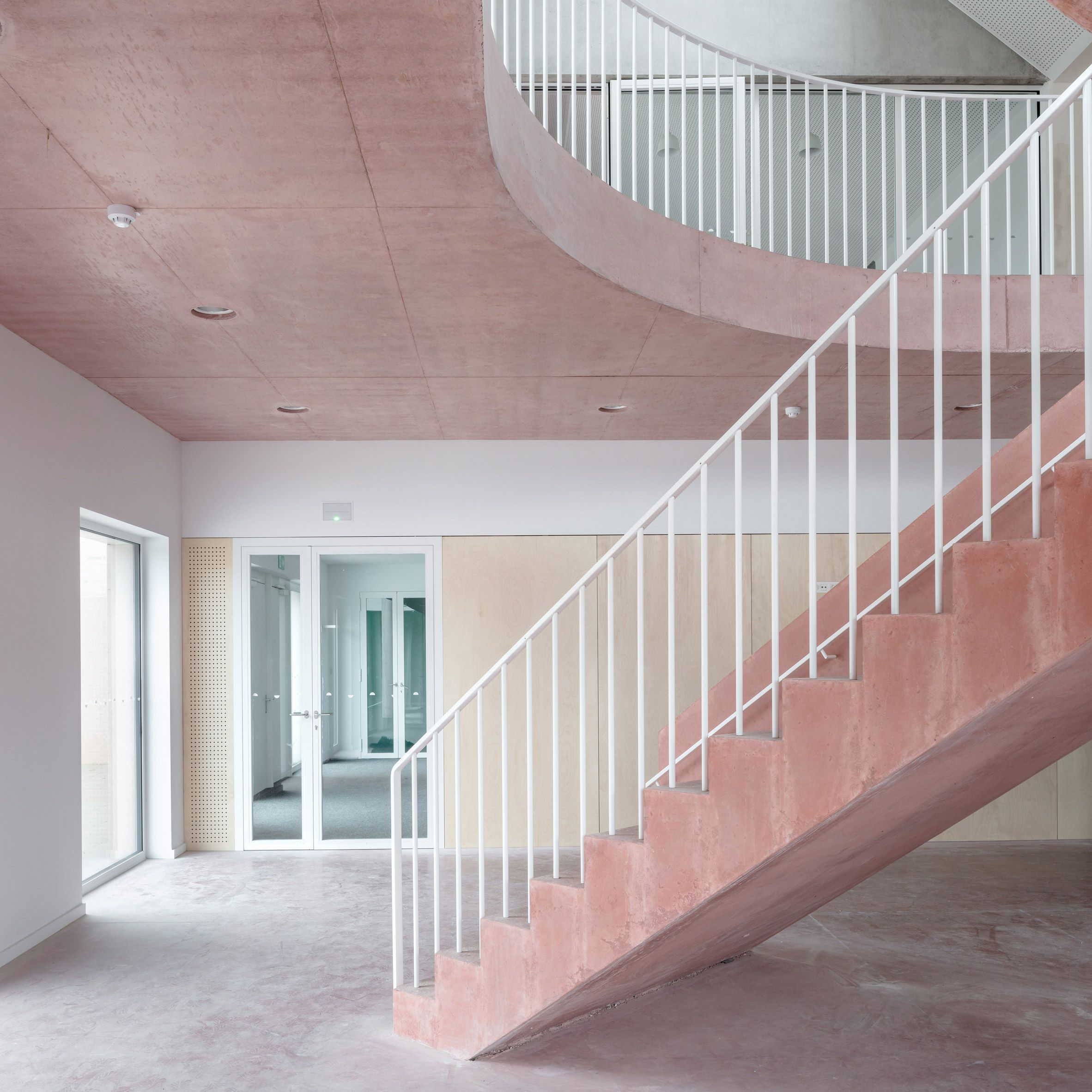 Best Pink Concrete Staircase Connects Colourful Floors Of 400 x 300