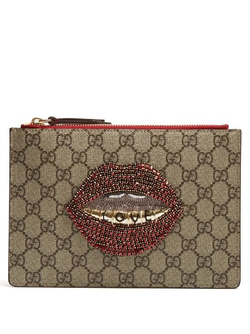 2a00eeb5c2d GUCCI Merveilles GG Supreme mouth-embellished pouch.  gucci  pouch ...