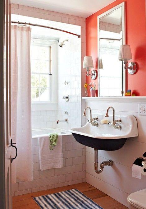 Coral walls. Subway tile tub. Hardwood floor.