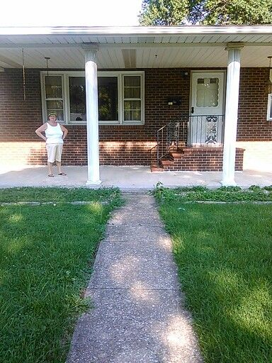 Side walk leads up to front porch. Plan on adding flowers to walkway
