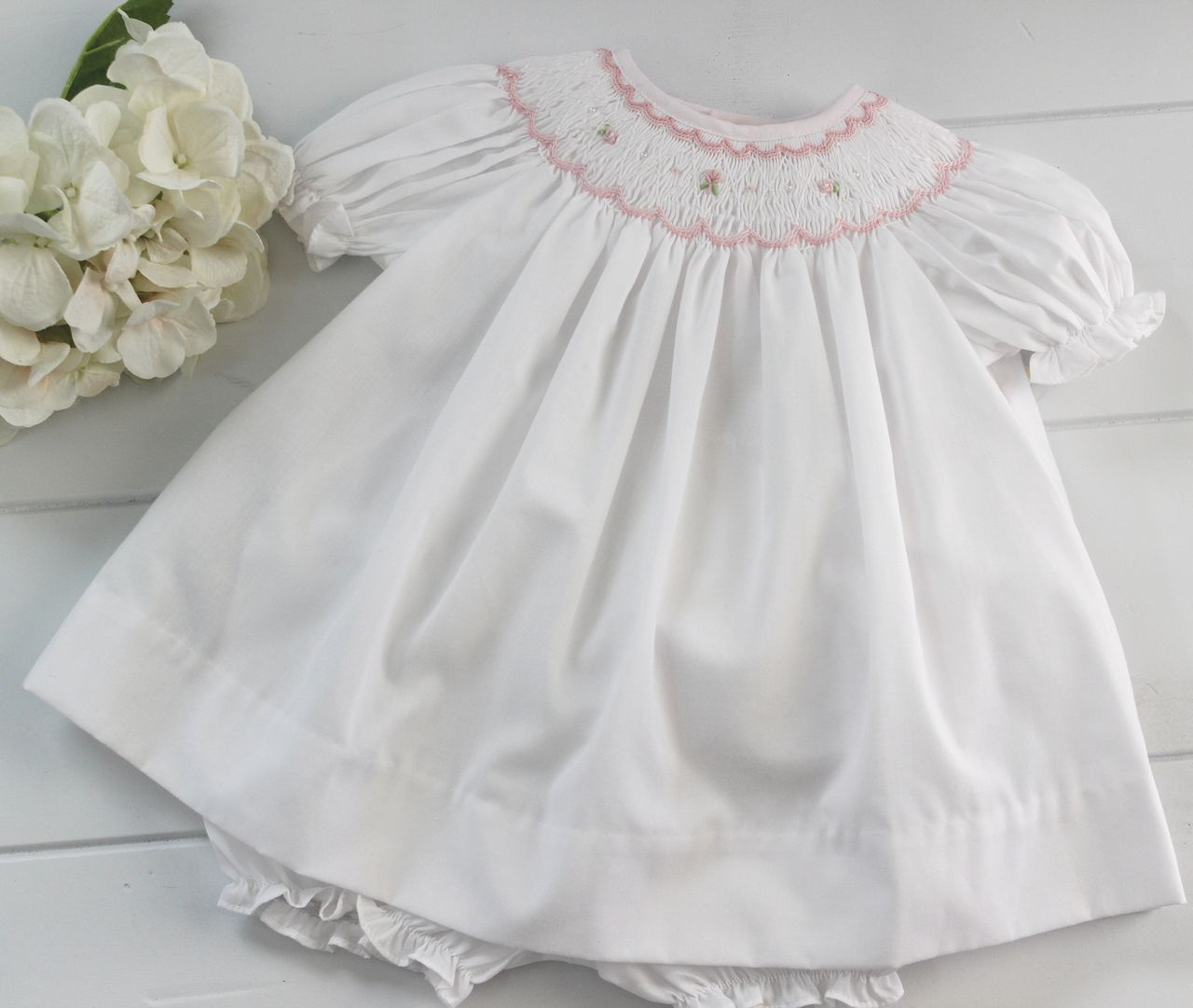 6057c630933e Hiccups Childrens Boutique - Petit Ami Girls White Smocked Bishop Dress  with Pink Smocking