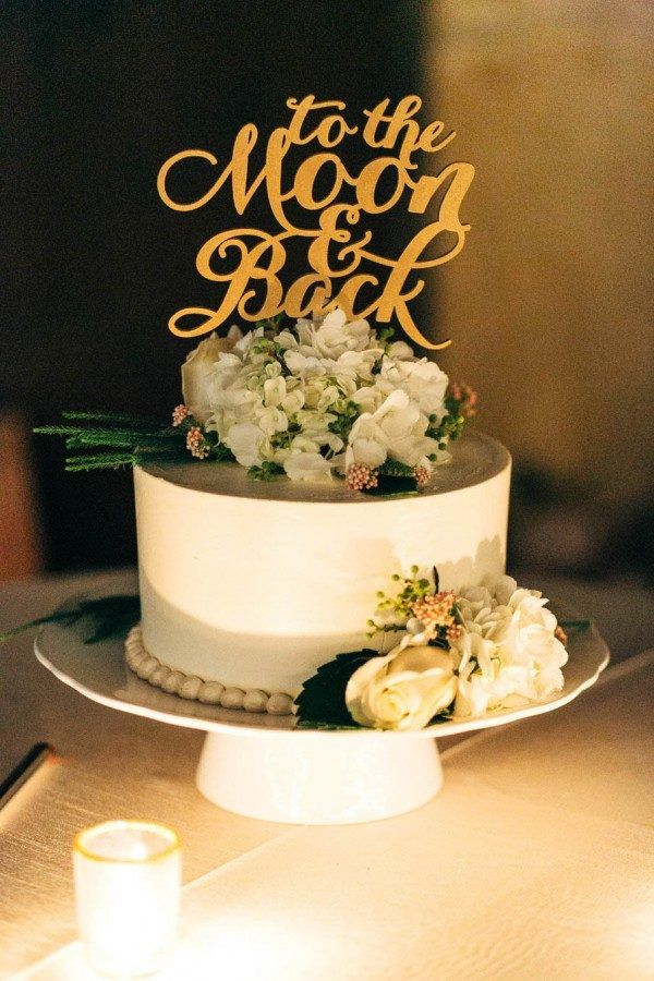 Round Wedding Cake With Floral Accents And Cute Phrase Topper