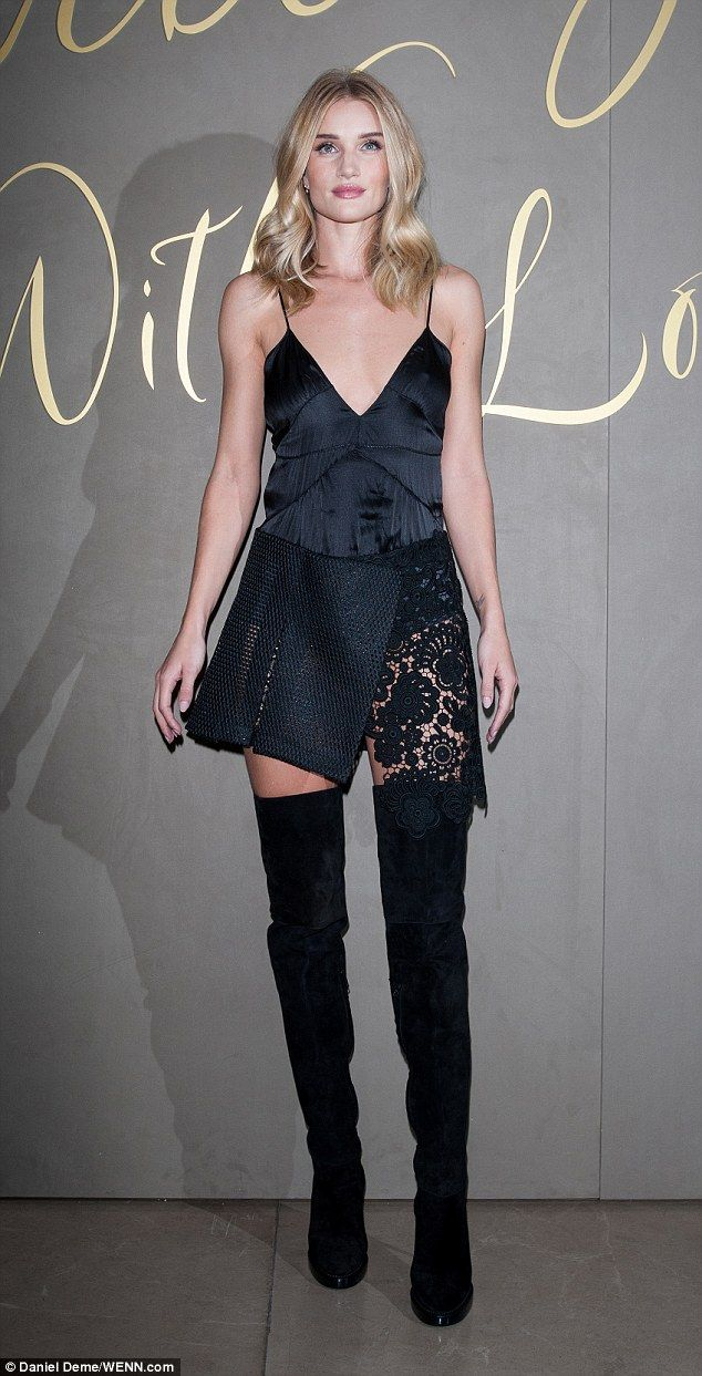 b43dfb4e8d9 Simply stunning  Rosie Huntinton-Whiteley made sure all eyes were on her in  a skimpy satin dress and thigh high boots at the Burberry film premiere on  ...