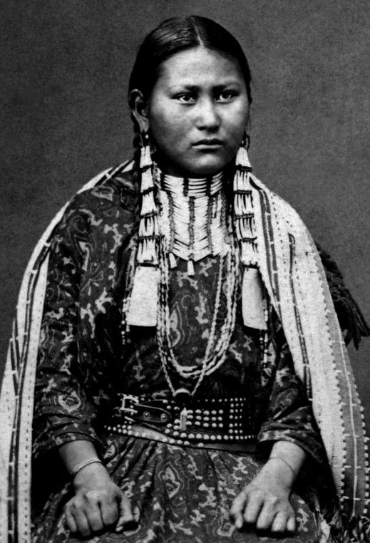 Dakota Sioux woman, Tall Prairie Chicken. Photographed between 1880-1900.