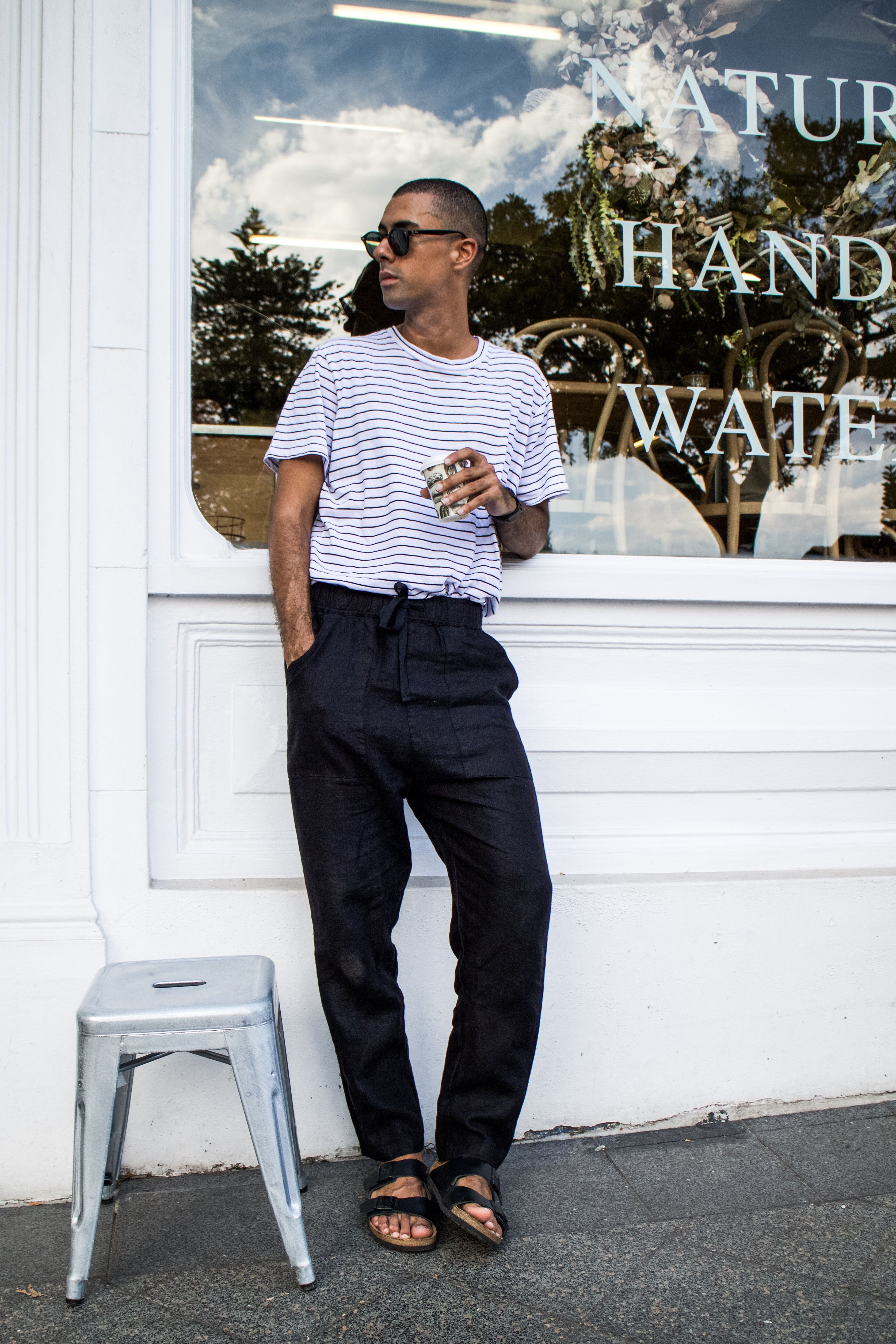 ad0b3397433 Mens Fashion Style   Outfit inspo by Blogger MR TURNER. Assembly Label linen  pants and striped tee with Birkenstock shoes.