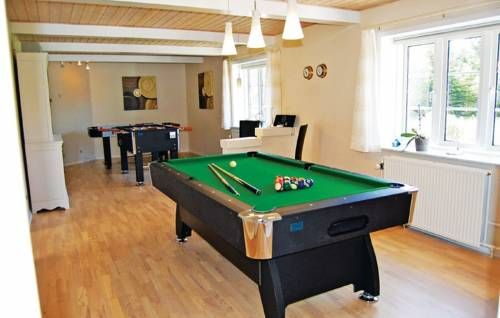 Holiday home Toldbodvej Bl�vand Holiday home Toldbodvej is located in Bl?vand.  This four-bedroom accommodation will provide you with a TV. There is a fully equipped kitchen with a refrigerator, dishwasher and a microwave. The private bathroom comes with a bath or shower.