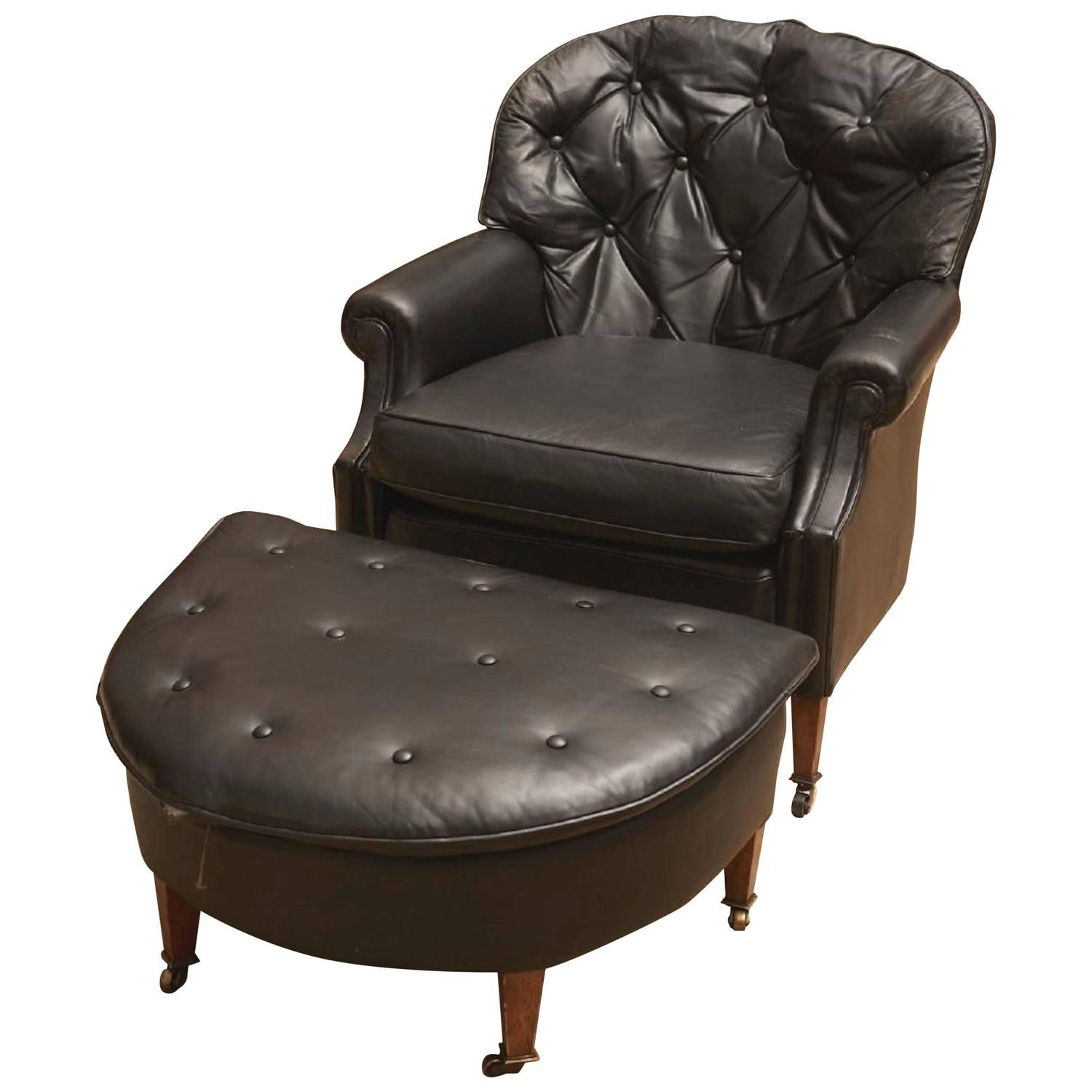 Black leather chesterfield club chair and ottoman with