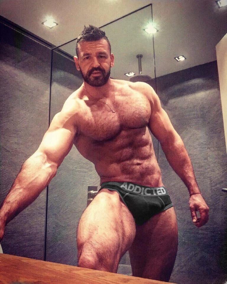 Muscle hunk posing in red underwear