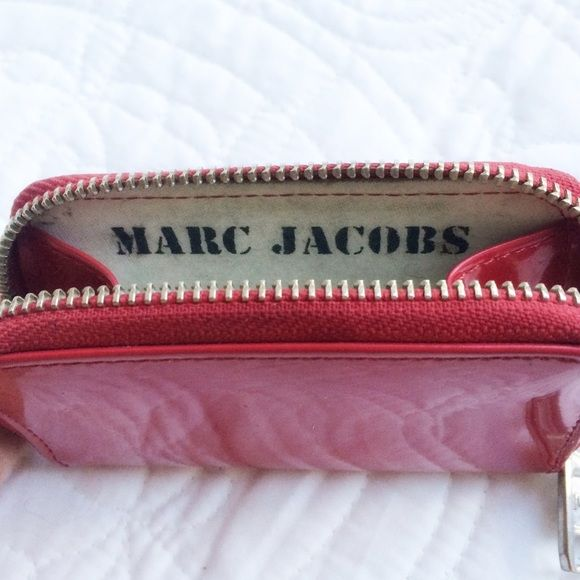 Marc by Marc Jacobs Tiny Zip Wallet Shiny red tiny zip around wallet that's perfect to hold your ID and money and to put in a small purse.  Has visible signs of wear (as shown in the pictures) but still really cute! Marc by Marc Jacobs Bags Wallets