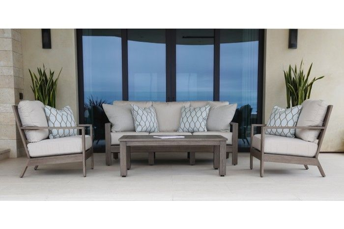 Relax On This Serene Patio With Our Laguna Club Chairs Sofa And Coffee Table Outdoor Dining Room Outdoor Furniture Cushions Wicker Patio Furniture Set