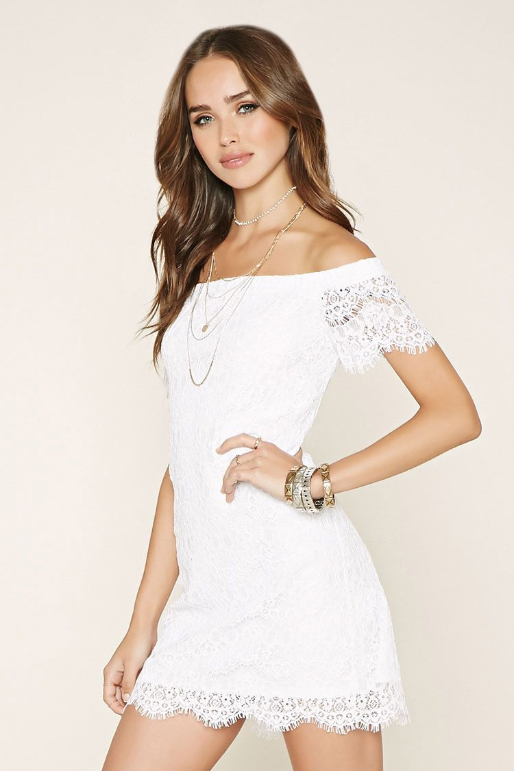 A knit mini dress crafted from a semisheer floral eyelash lace with