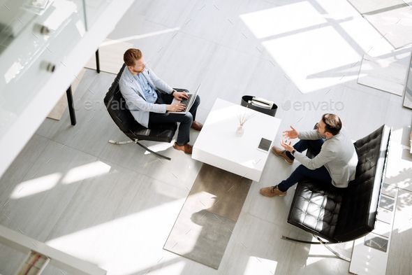 Business meeting in lobby by nd3000. Business meeting in lobby by two businessmen #Sponsored #meeting, #Business, #lobby, #businessmen