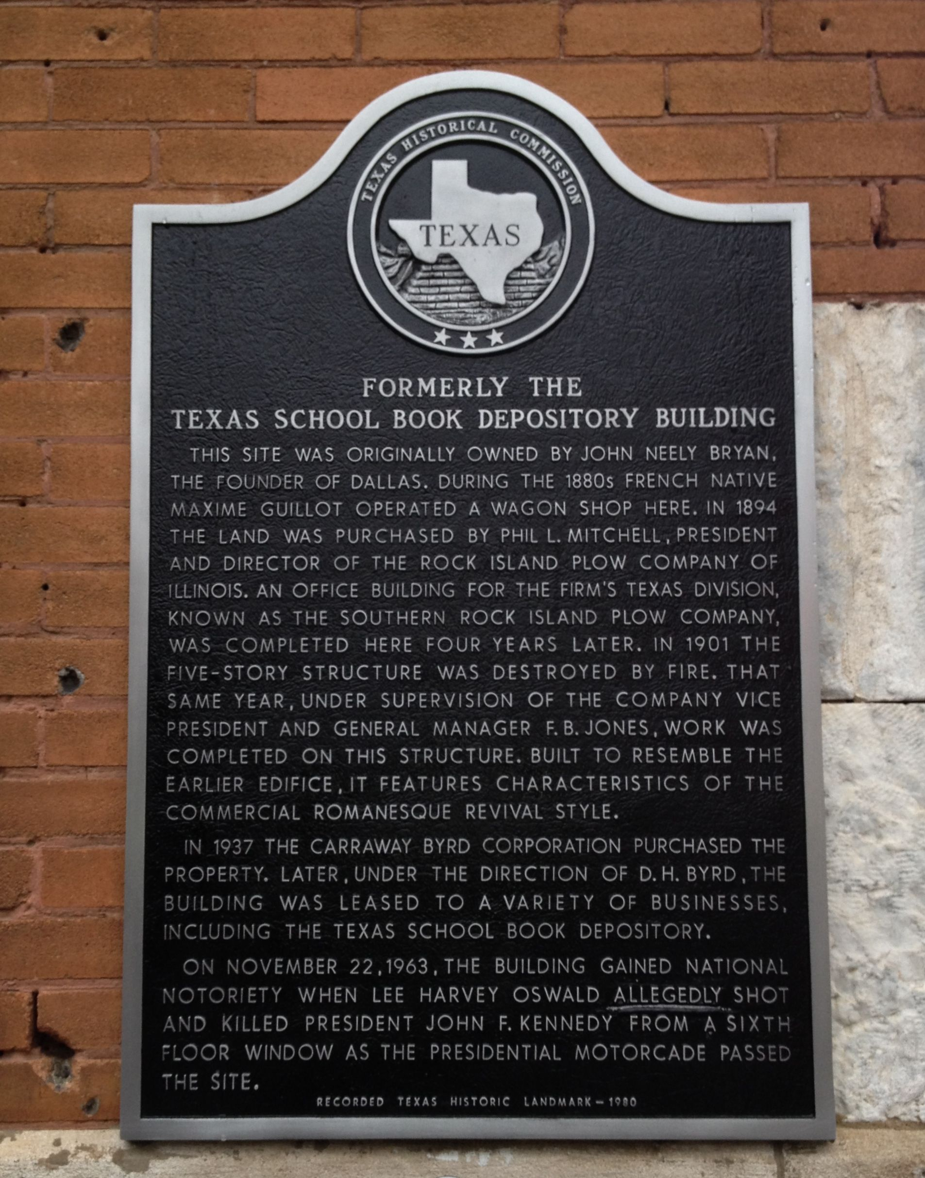 Plaque at the former Texas School Book Depository, now the