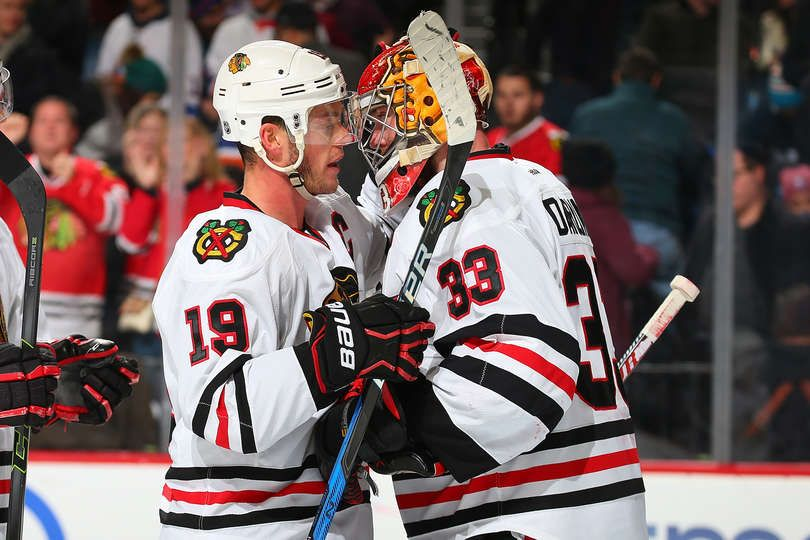 New York Ny December 15 Scott Darling 33 Of The Chicago Blackhawks Celebrates After Defeating The New York Islanders 5 4 With Teammate Jonathan Toews 19 A