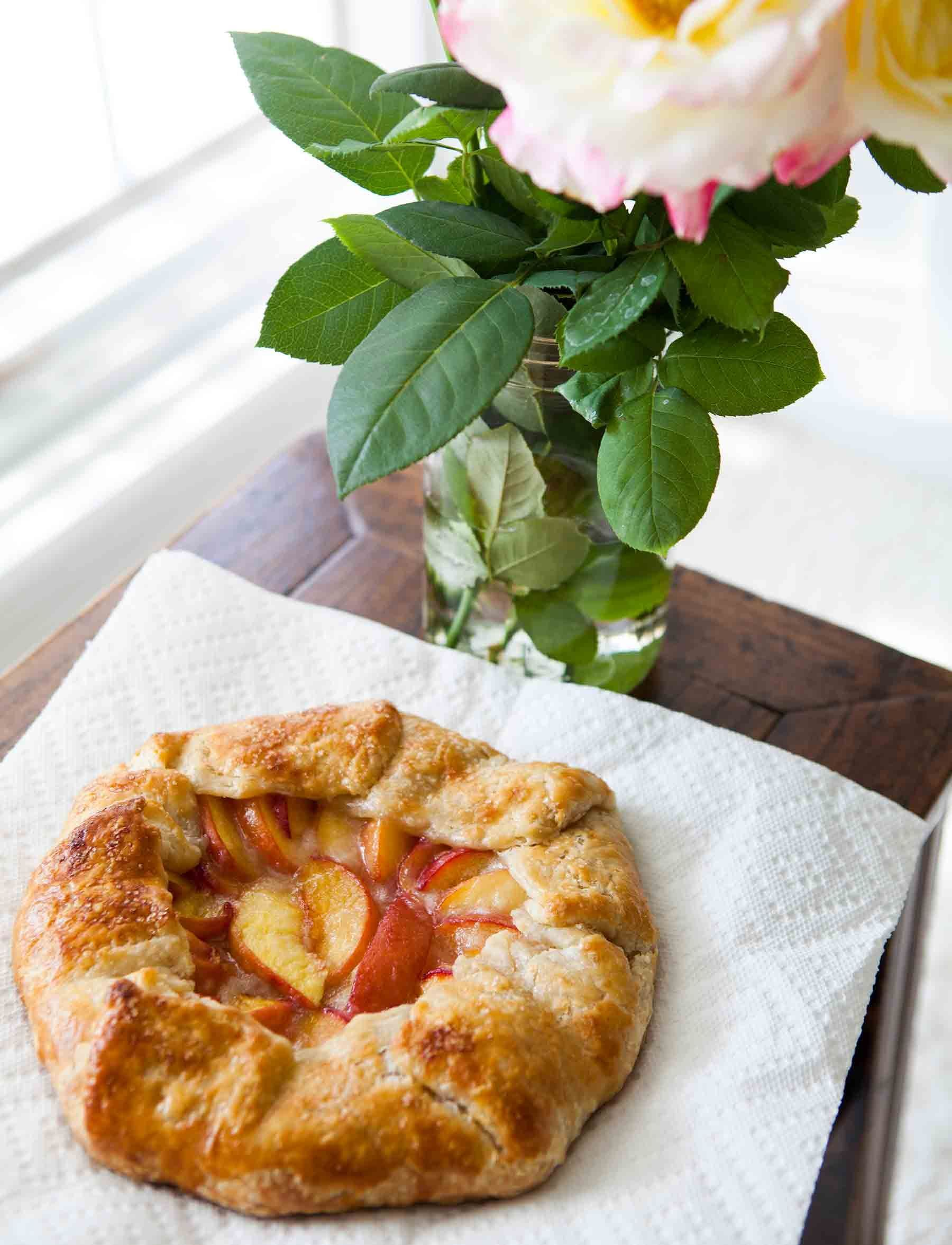 Beautiful Peach Galette! Rustic tart made with slices of fresh yellow peaches in a simple butter crust. So easy to make this free-form tart! On Peach Galette! Rustic tart made with slices of fresh yellow peaches in a simple butter crust. So easy to make this free-form tart! On