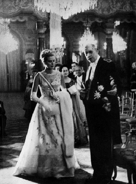 The French president Charles de Gaulle with the Princess Grace at a function in the Elysee palace in Paris, October 13, 1959. Grace also wore this elegant gown, designed by Lanvin-Castillo of Paris, to the Opera in Monaco at the time of her wedding festivities.It is silk, with beads and silver sequins. On display in Montreal exhibit.