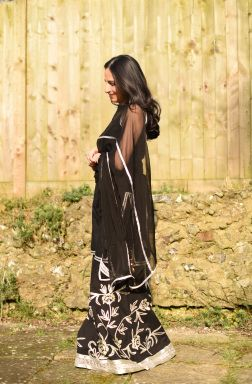 Black and Silver Sharara: Pretty and Comfortable. Black Sharara with large silver embroidered flowers. Worn with a matching kurta and dupatta.