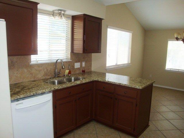 Kitchen  features granite tops, new deep under mount sink, new faucet, new tile backsplash.(4/2014)