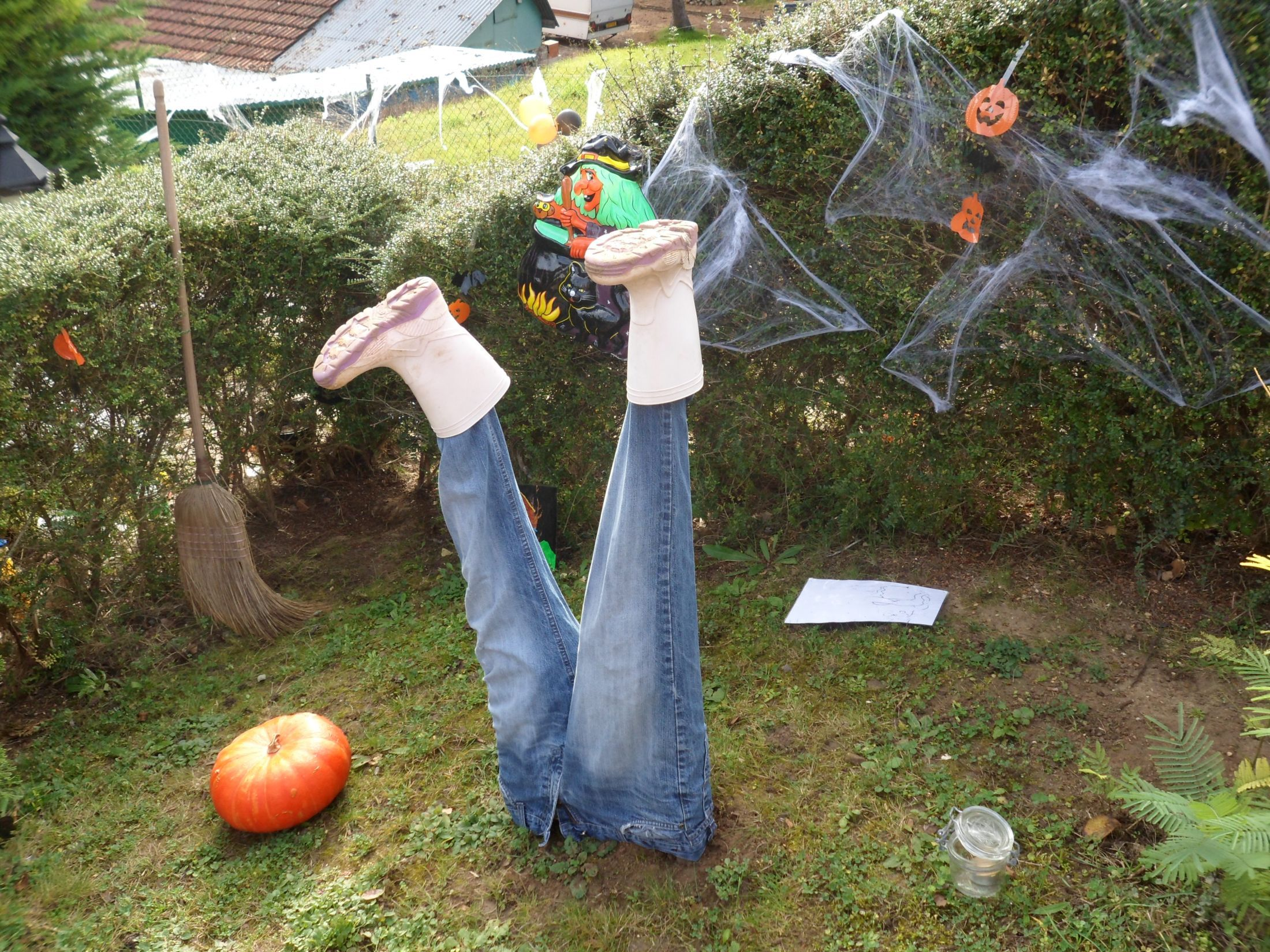 very frightening to the design of the body half buried in the ground - Halloween House Decorating Ideas Outside