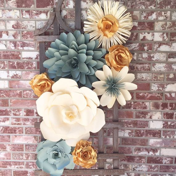 this collection of handmade paper flowers will make a wonderful wall decor in the home  office