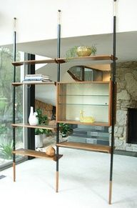 Mid-century modern tension pole room divider shelving.