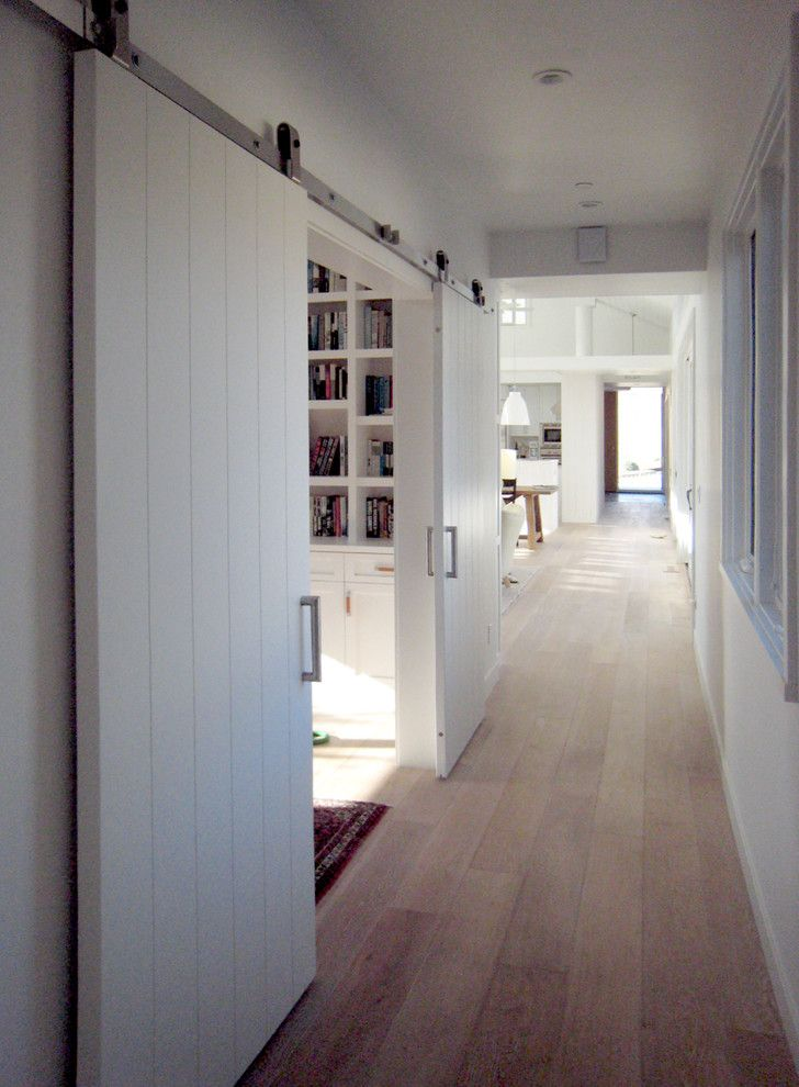Doors Designs Marvelous Barn For Homes With White Wooden Sliding And Light Brown Wood Flooring Also Walls Bookcase