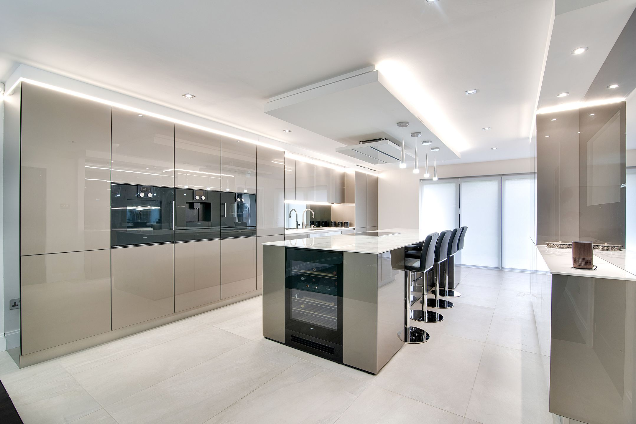 Stunning Contemporary Kitchen Units We Love The Floor To Ceiling Cabinets And The Lighting A Modern Kitchen Cupboards Modern Kitchen Floor To Ceiling Cabinets
