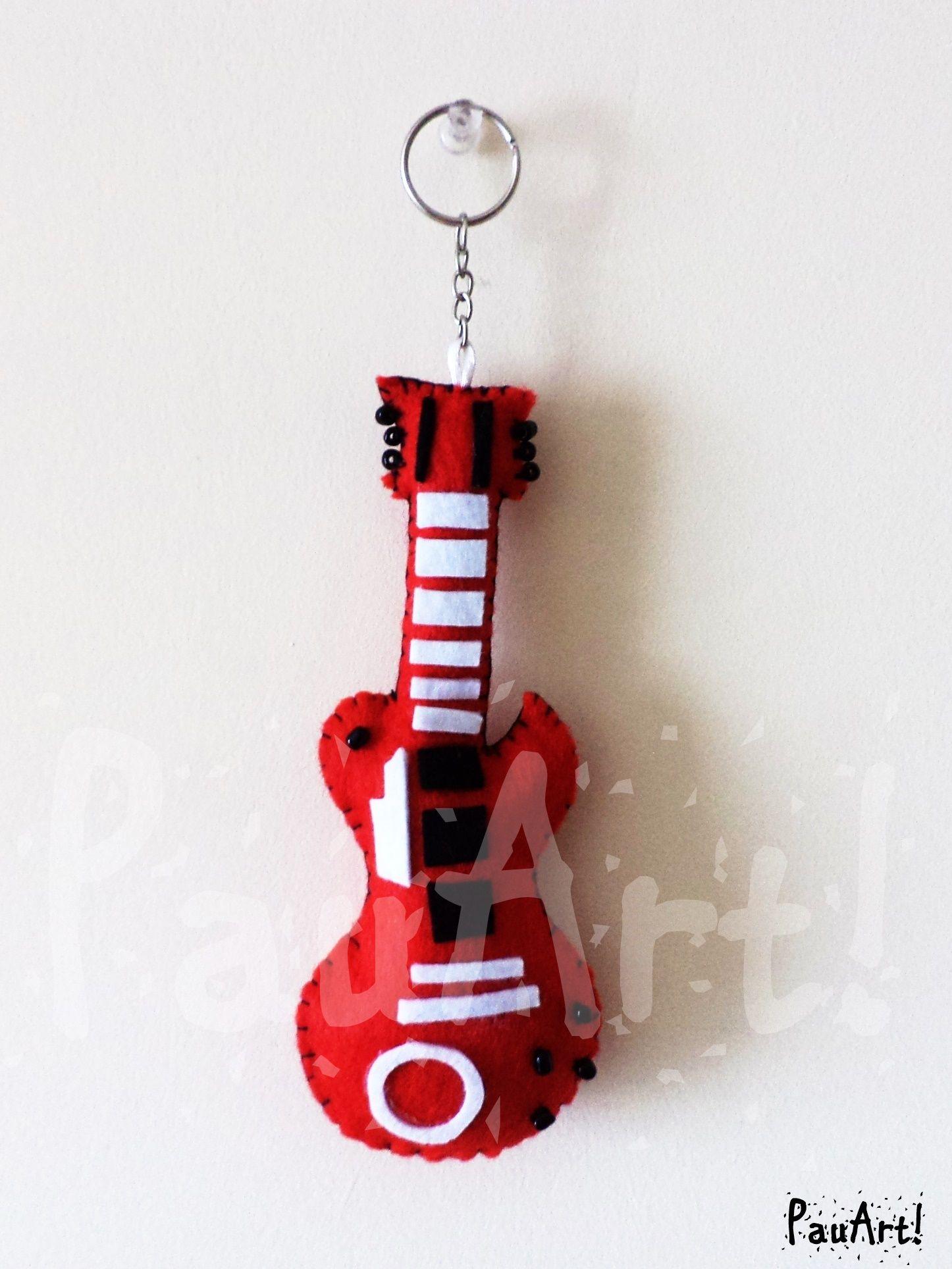 Guitarra eléctrica roja Confeccionado a mano con fieltro y relleno sintético.