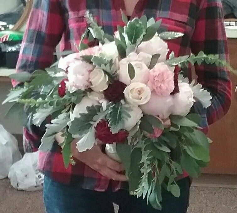 Pale pink, blush and dark red bridal bouquet with peonies, garden