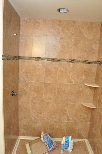 Tips for installing corner shelves in tile shower - steps to tile a shower