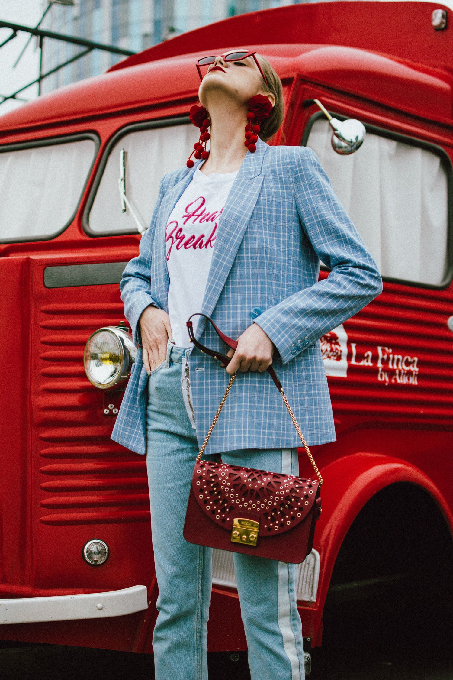 Baby blue checked blazer, statement jeans, furla metropolis red bag, small sunglasses, tee, andreea birsan, couturezilla, cute spring outfit ideas 2018, baby blue blazre, how to wear pastels this spring, jeans with constrastic side panel, redone jeans, reconstructed jeans trend, how to wear reconstructed jeans, red pom pom statement earrings, small cat eye sunglasses in red, retro small sunglasses, small sunnies, matrix sunglasses trend, micro sunglasses trend, red earrings, red and baby…