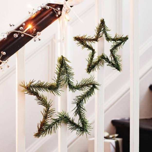 Simple little Star Wreaths hang from a twinkling Garland - christmas decor pinterest