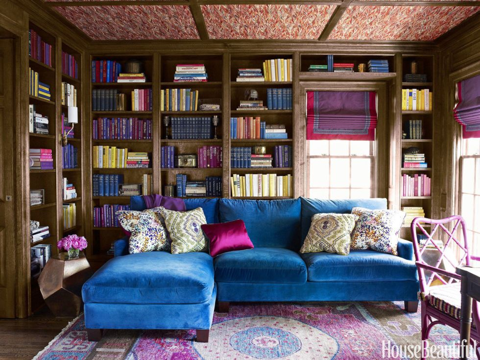 <p>With its lush dose of ultramarine, a custom Lee Industries sectional sofa covered in Fabricut's Renaissance velvet adds vibrancy to a traditional library. For more zing, Harper painted the client's desk chair in Benjamin Moore's Mulberry. Oriental rug, Stark. Pheasant wallpaper on the ceiling, Twigs.</p>