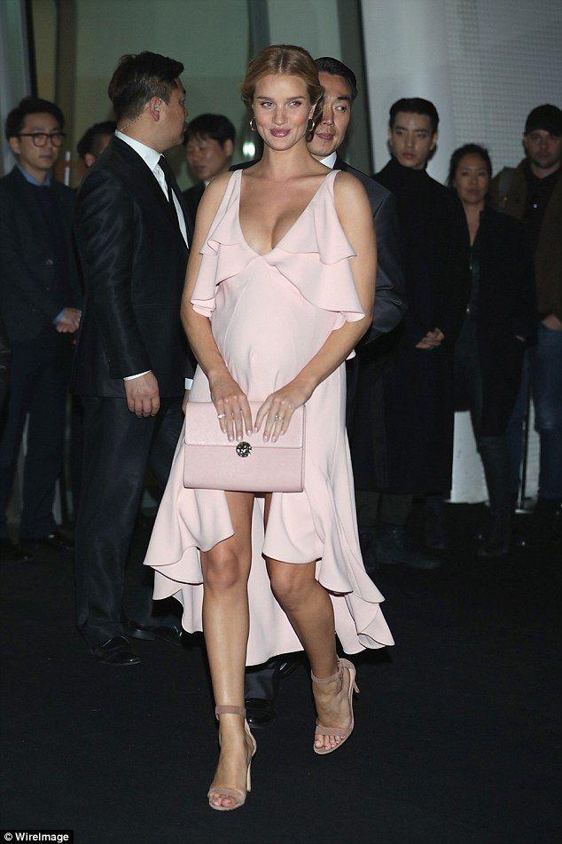 8b1b31a6d Pregnant Rosie Huntington-Whiteley displays her bump in tight dress ...