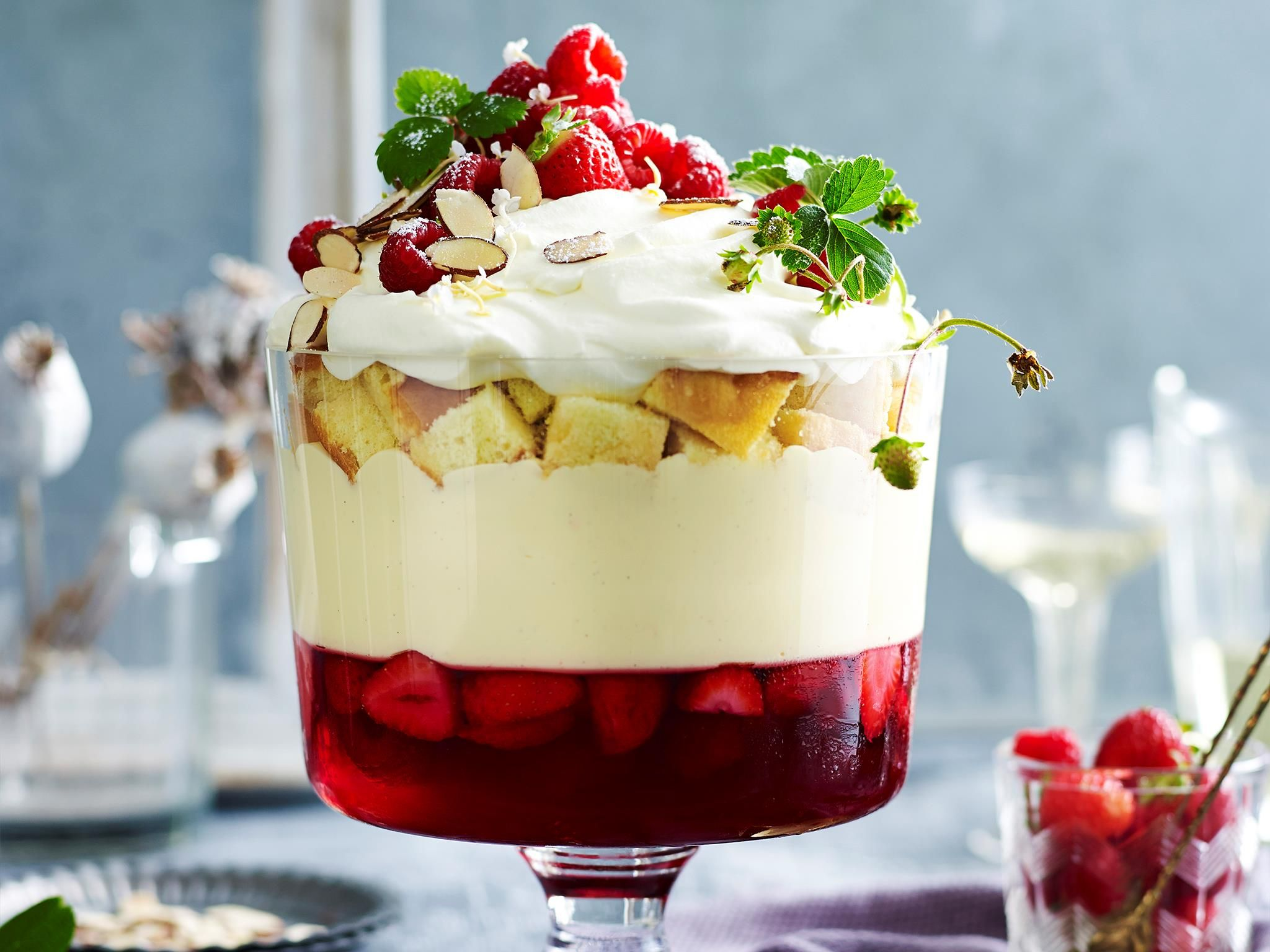 this traditional christmas dessert is absolutely divine layered with fresh strawberry and raspberry jelly creamy mascarpone custard and sherry soaked