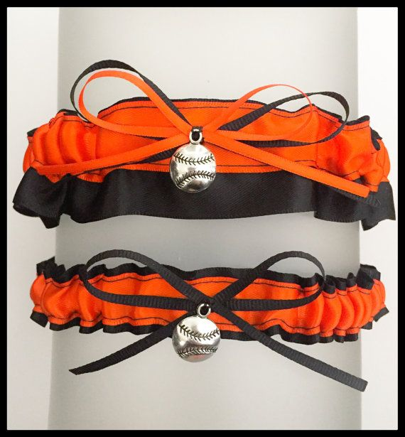 "Very Sexy Black & Orange garter Set embellished with a coordinating bow featured with a Charm Embellishment for added elegance.    ** Garter measures: 1.5"" W **  ** Toss Garter Measures: 7/8"" W **    * Garter listing is for standard size, if interested in custom size please contact prior to purchasing. * 