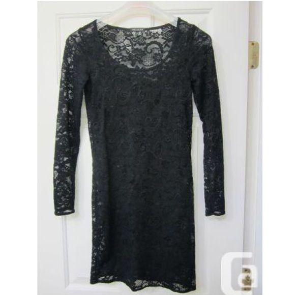 Lace dress Black long sleeve body-con dress.  Couple unnoticeable snags on the sleeve as pictured.  Talula for Aritzia Aritzia Dresses