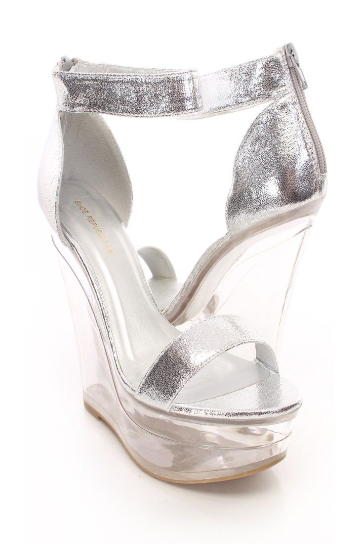 You will be head over heels for these saucy little numbers! They will perfectly compliment any outfit for any occasion! Make sure to add these to your collection, they definitely are a must have! The features for these platform wedges include a crinkle texture glossy faux leather upper, open toe, stitched detailing, back zip up closure, smooth lining, and cushioned footbed. Approximately 5 inch wedge heels and 1.5 inch platform.