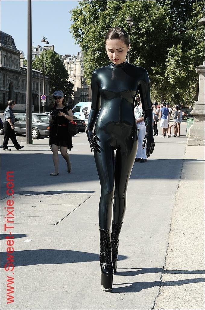 Trixie in latex walking in public street | costume