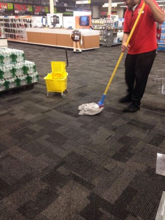 Funny Carpet time to mop the carpet. fool uses wrong tool for the job at