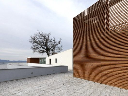 Health centre and houses for elderly people ipostudio architects also pinterest rh nz