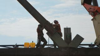 Iron workers Matt Gelbke and Frank Gasior work on Tower Four at the World Trade Center site.