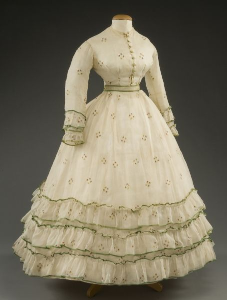 Crinoline Daytime Dress: either one piece with a bodice and skirt seamed together at the waist; princess style, without a waistline seam; or two pieces with matching but separate bodices and skirts. Armholes were low on the arm. High necklines with varying sleeves.