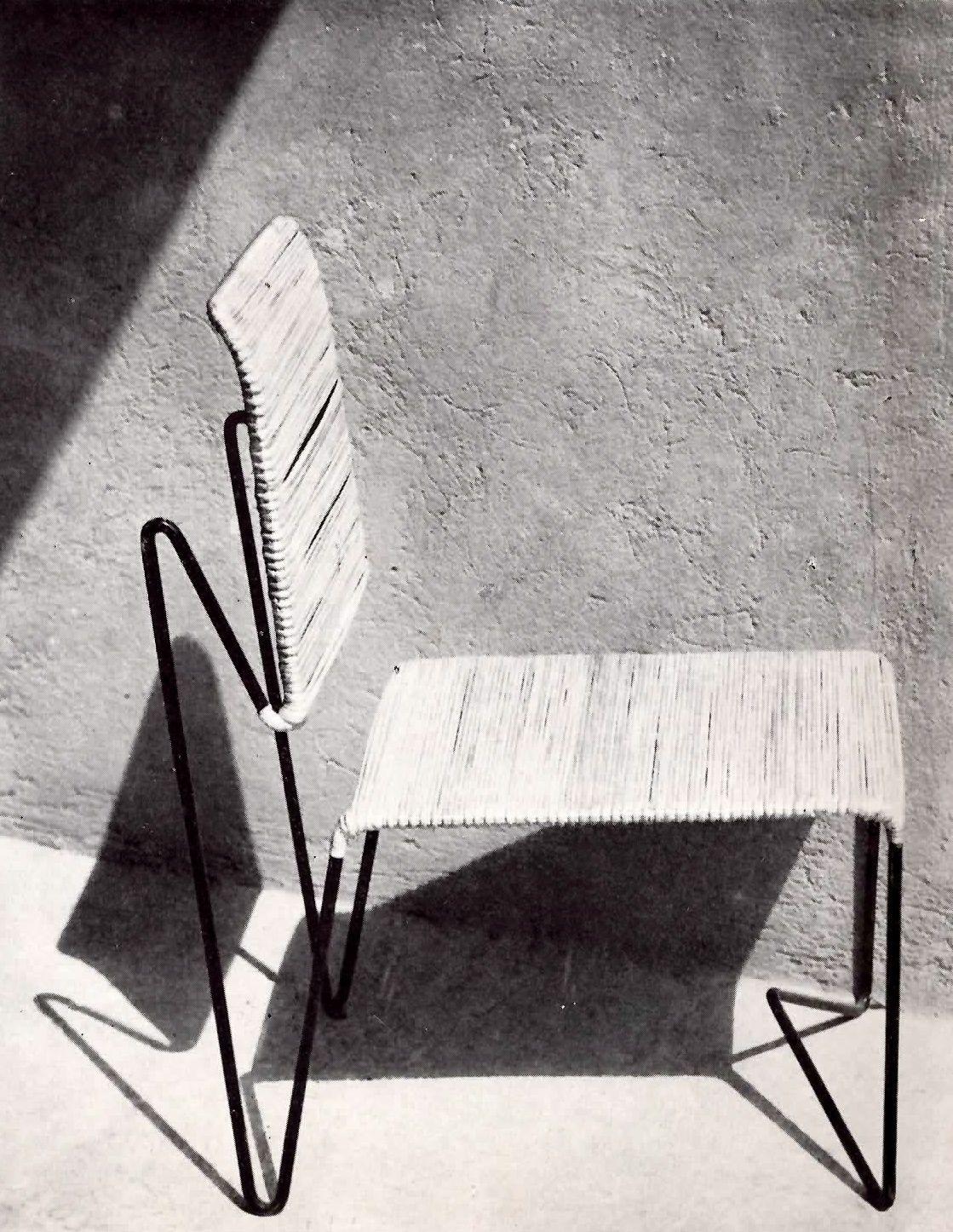 Silla de varilla de hierro aire Tejido de mimbre por Clara Porset ...