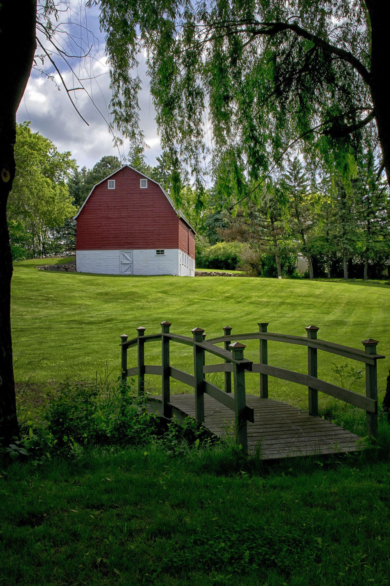 https://flic.kr/p/HEJ7kM | Bridge to the Barn | A beautiful scene of small bridge leading to a well kept barn on a hill.  Located near Hackamore Road & Brockton Lane N. in Corcoran, MN.