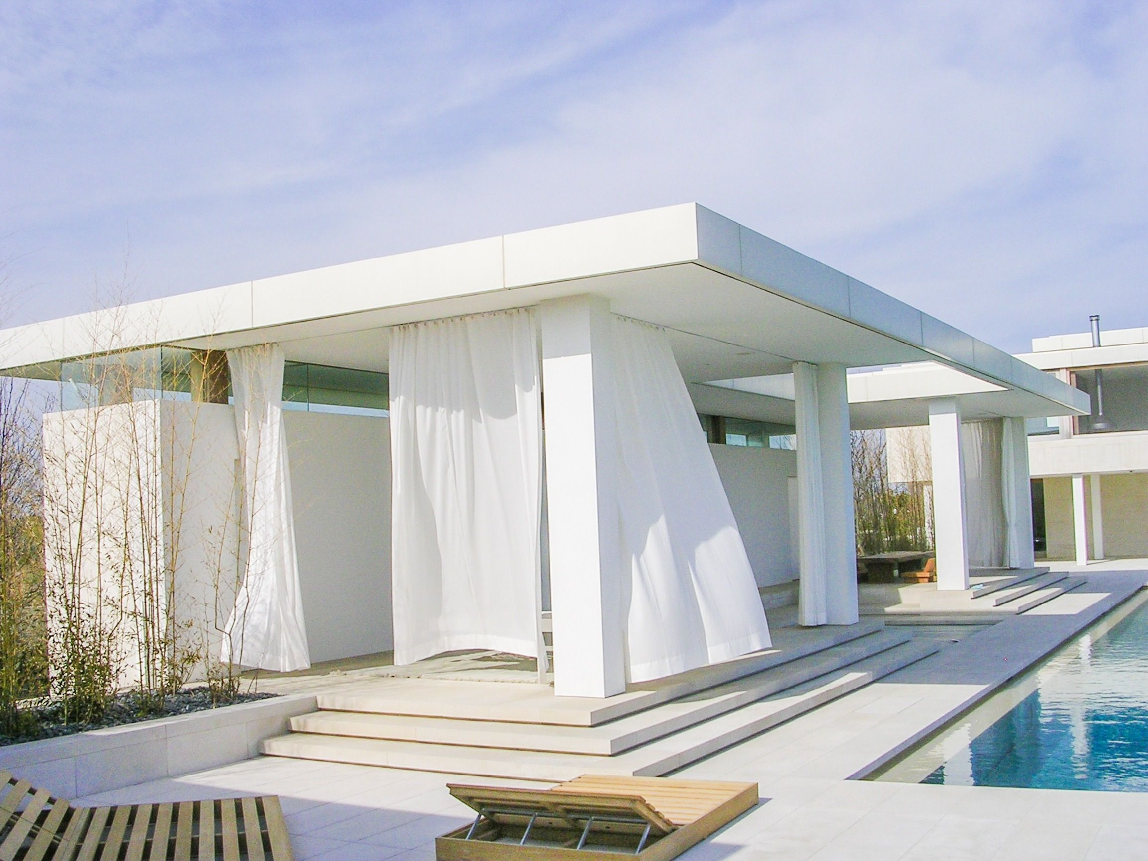 Beautiful white drapery outside by a pool in the Hamptons. interior ...