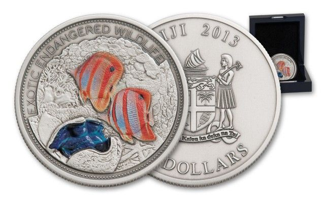 2013 Fiji 2-oz Silver Great Barrier Reef Antique / This 2013 Two Ounce Silver High Relief Great Barrier Reef Silver Commemorative features a stunning image of colored fish and coral.