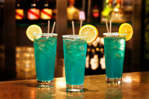Blue crush cocktails with rum on bar counter